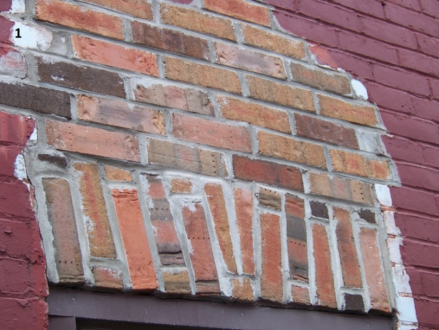 Picture 1 section of a brick wall that is different color than the rest