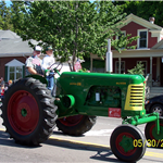 antique green tractor in parade