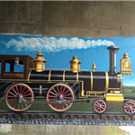 mural painting of a black train engine with gold trim and red trim on wheels blue sky with smoke com